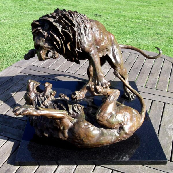 bronze sculpture of lions