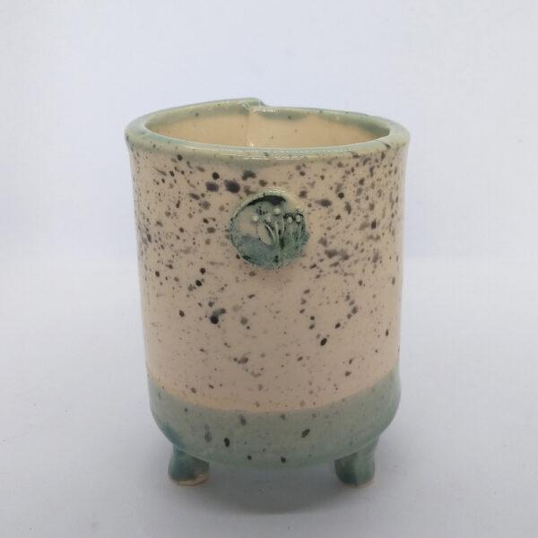 small round three-legged pot