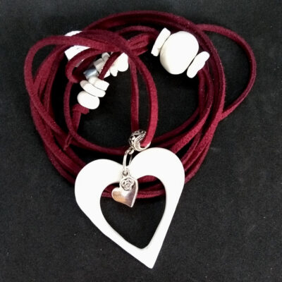 white heart on red cord